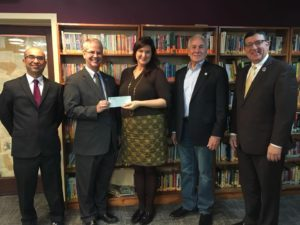 Michigan Masonic Charitable Foundation presenting check to 826michigan executive director Amanda Uhle