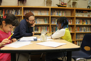 luke jackson working with writing club students