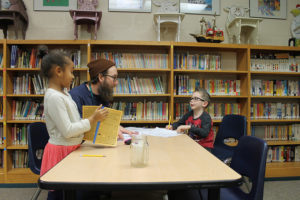 luke jackson working with writing club students some more