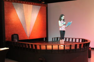 student reading on historic blue bird inn stage at stamps gallery