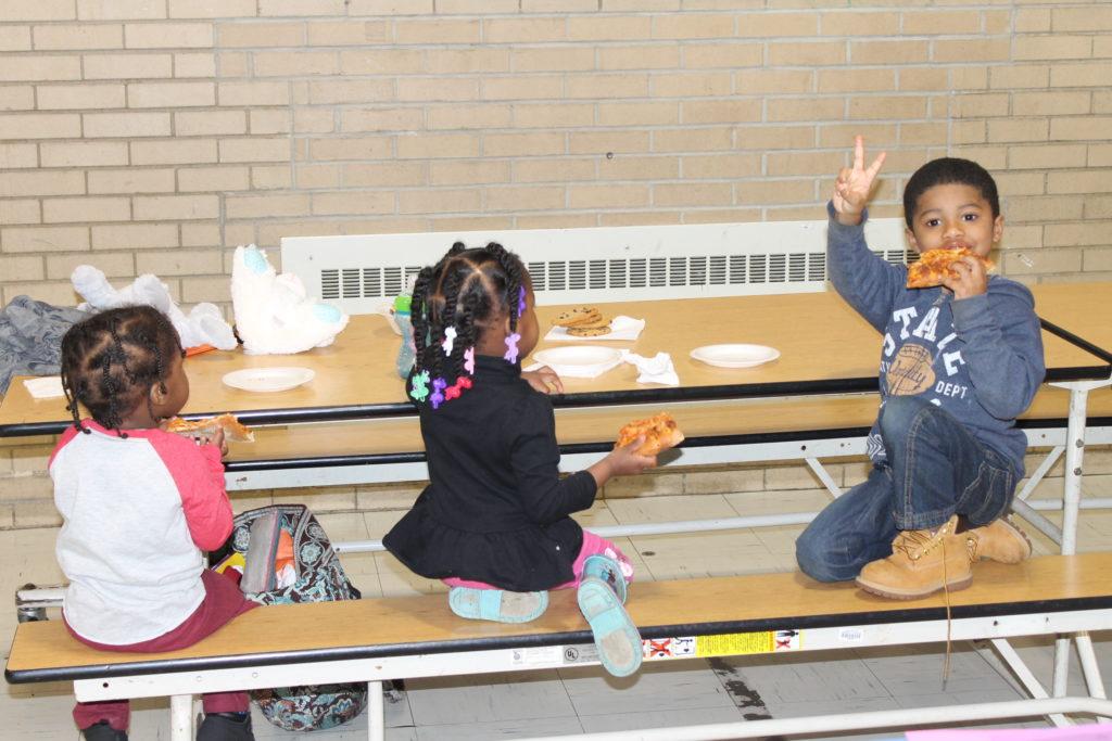 students enjoying domino's pizza at family writing laboratory