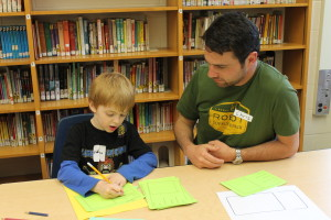 chris with student at family write night